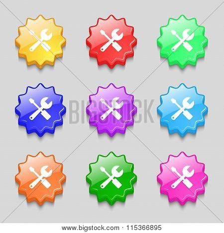 Wrench And Screwdriver Icon Sign. Symbol On Nine Wavy Colourful Buttons.