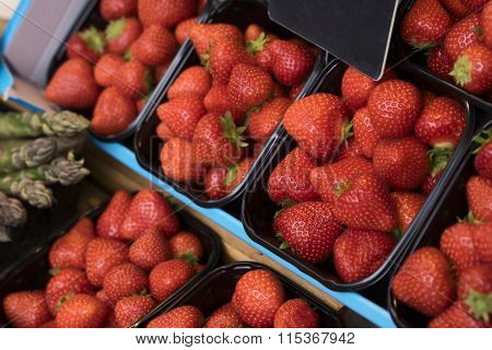 Fresh Red Strawberries On Market Stand For Sale