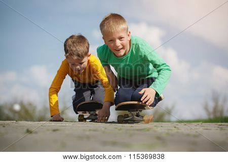 Two Little Boy  Skating On The Street In Summer