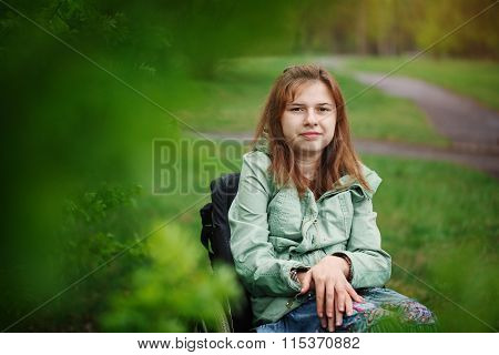 Portrait Of A Yong Beautiful Woman Smiling In A Wheelchair In Th