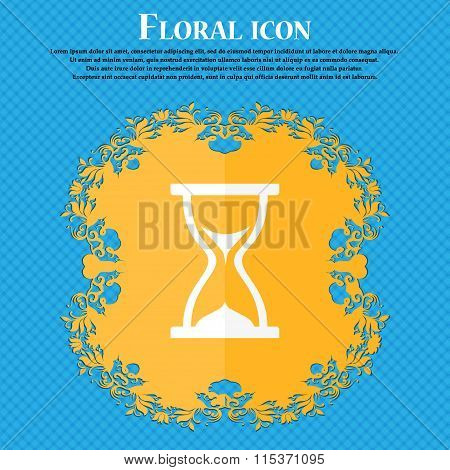 Hourglass Icon. Floral Flat Design On A Blue Abstract Background With Place For Your Text.