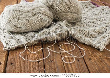 The Knitting On The Wooden Table
