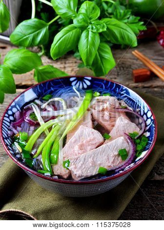 Traditional Vietnamese soup Pho with rice noodles, spring onions, onions, anise and cinnamon