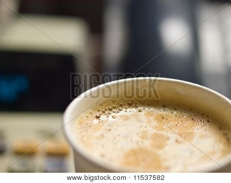 Cup Of Coffee In A Paper Cup On A Office Desk