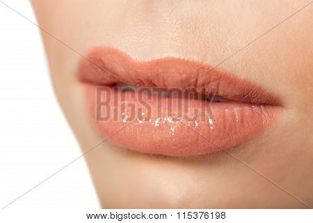 Sexy Lips. Beauty Lipgloss Makeup Detail. Beautiful Make-up Closeup.