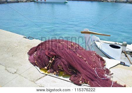 greek island fishing nets and a boat