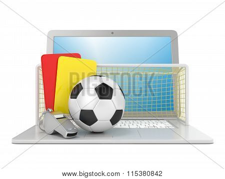 Football concept. Penalty (red and yellow) card metal whistle soccer (football) ball and gate