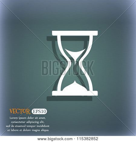 Hourglass Icon. On The Blue-green Abstract Background With Shadow And Space For Your Text.