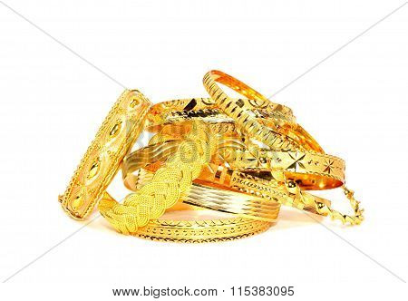 Gold bracelets on white