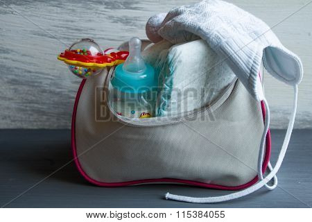 Women Handbag With Items To Care For The Baby