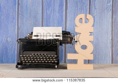 Antique black typewriter in interior at home