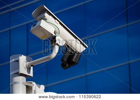 Surveillance Camera In Front Of Building