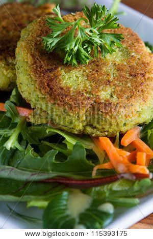 Falafels Served On A Green Salad