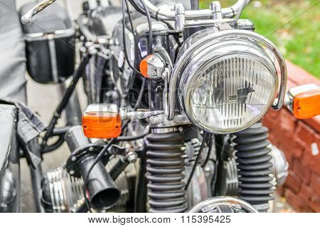 Close-up Of A Motorcycle Headlight. Horizontal View Of A Motorcycle Headlight, Daytime..