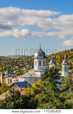 A Village's Church In A Sunny Day. Vertical View Of The Village's Church In A Sunny Autumn Day, With