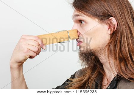 Man With Clogged Nose By Clothespin
