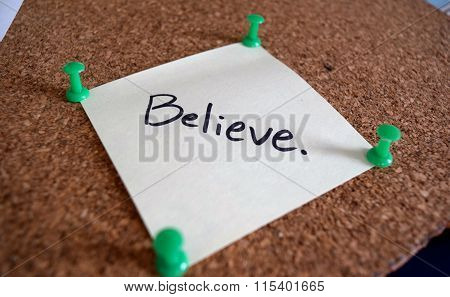 The Word Believe Written On A Sticky Note As A Motivational Message