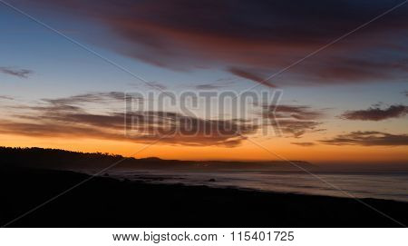 Pacific Coast Sunrise Dramatic Saturated Orange Hues Over Ocean