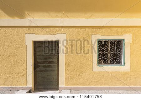 Yellow wall with door and window