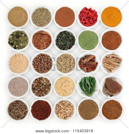 Superfood and herb selection for men in porcelain bowls over white background.
