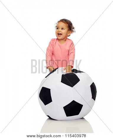 happy mulatto little baby girl playing with ball