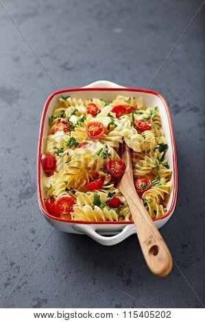 Pasta bake with mozzarella and cherry tomatoes