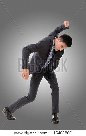 Struggle pose of Asian business man, full length isolated.