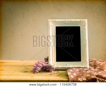 White Vintage Photo Frame With Sweet Statice Flower On  Wooden Table , Romance Concept