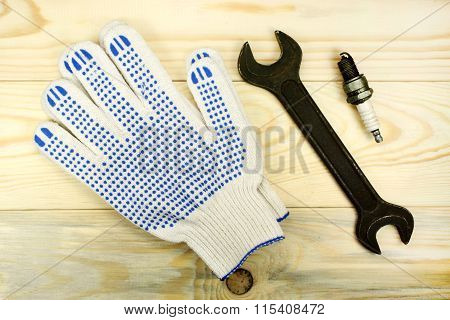 Open-end Wrenches With The Spark Plug And Protective Gloves