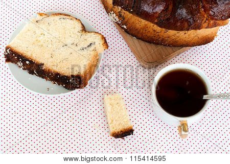 Delicious Cake With Poppy Seeds And Black Tea Closeup