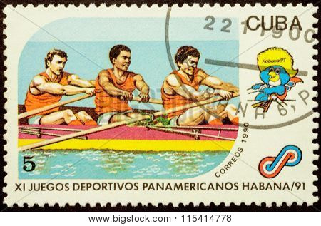 Men Rowing On Postage Stamp