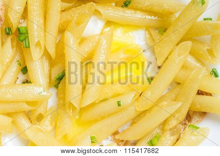 Italian Penne Pasta On A Plate With Egg
