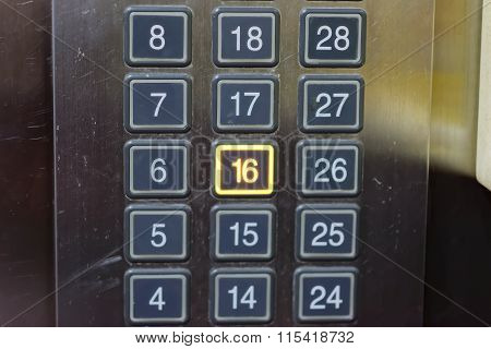 Elevator Button With Number 16 Pushed