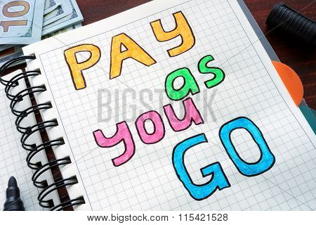 Pay as you go PAYG written on a notebook.
