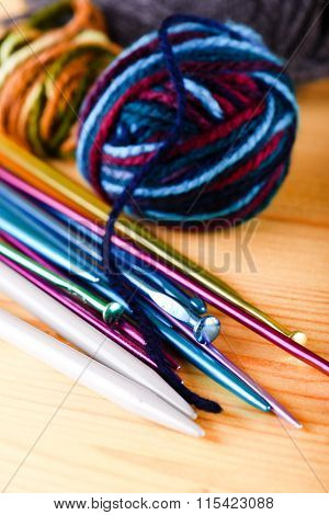 Several Color Knitting Needles With Balls Of Wool