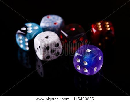 Six Color Dices On Black Board
