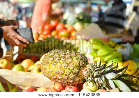 Sale, shopping, consumerism and pineapple in grocery market