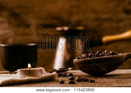 Fragrant Fried Coffee Beans. Light  Burning Brightly Candles On Old Wooden Background.
