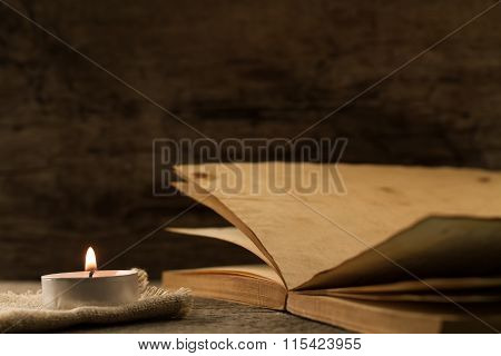 Light  Burning Brightly Candles On Old Wooden Background. Spa, Meditation, Ritual, Flavored. Writing