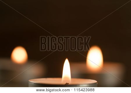 Light  Burning Brightly Candles On Old Wooden Background. Spa, Meditation, Ritual, Flavored.