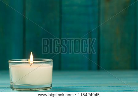 Light  Burning Brightly Candles On Old Wooden Background. Spa, Meditation, Ritual, Flavored. Turquoi
