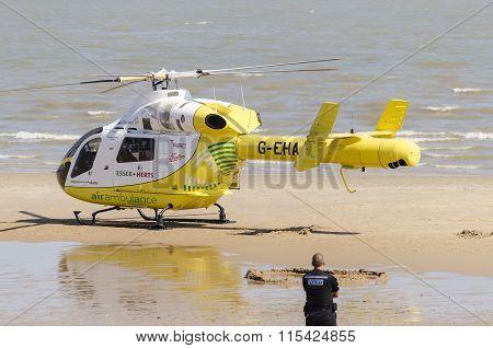 Air ambulance landing on the beach