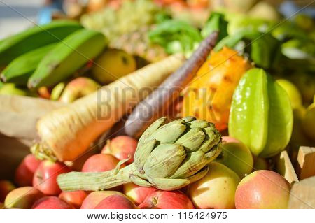 Mixed fruits and vegetables on market stall