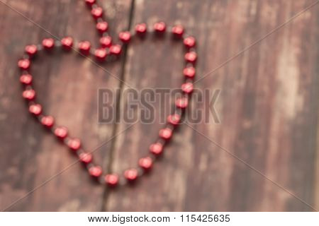 Blurred  Red Heart On A Wooden Table. Background Valentine's Day