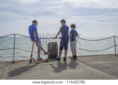 Three friends at the end of the pier