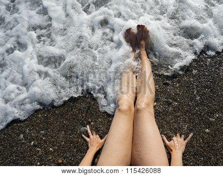 Female Feet On The Seashore