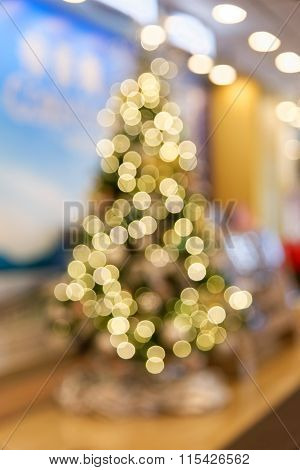 Blurred Out Of Focus Yellow Lights Of Christmas Tree