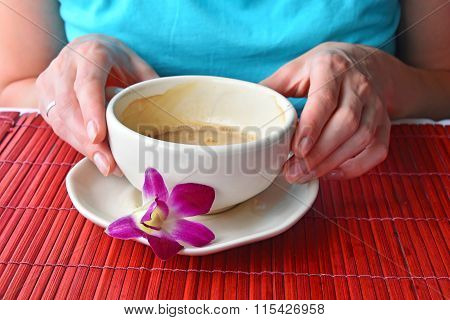 Two Woman Hands Holding Coffee Cup With Flower