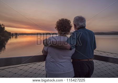 older couple watching sunset