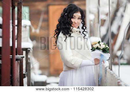 Attractive East Asian beautiful brunette bride in white wedding dress decorated with bandage on her